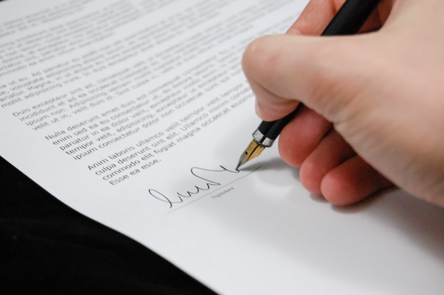 hand signing a legal document